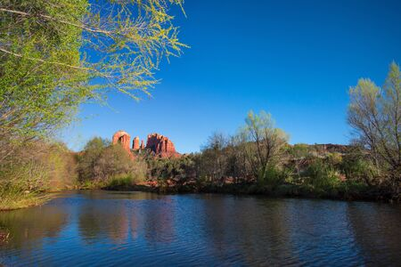 View of red rocks and river at the foot hills of the famous Castle Rock in Sedona, Arizona, AZ, an American landmark