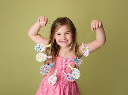 Child with Easter activities and crafts with bunny stickers, Easter Egg shapes in a banner Фото со стока