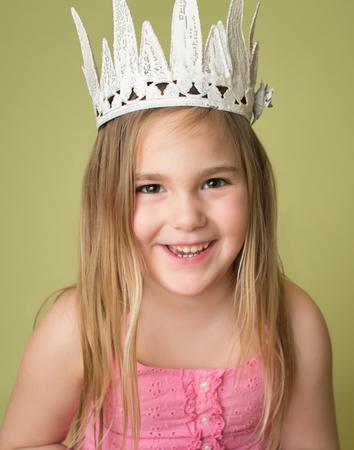 pretend: Happy, smiling girl wearing a white crown, princess pretend play