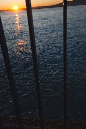 Sunset through the bars