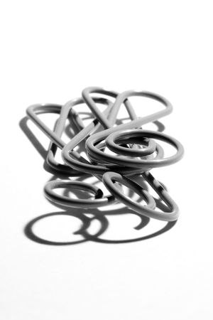 Bass clef paper clip black and white Stock Photo