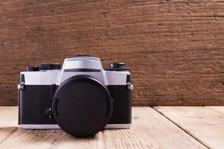 Vintage camera on wood background.