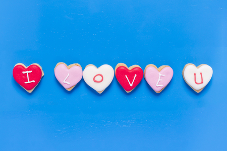 I Love You - Heart shaped cookies on blue wood background.