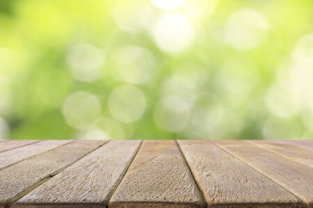 Old wood table on abstract green background. For display your products.