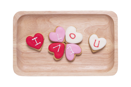 i love you heart: I Love You - Heart shaped cookies in wood dish on white background. Stock Photo