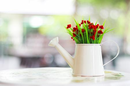 Plastic flower vase on the table.(Blurred background) Reklamní fotografie