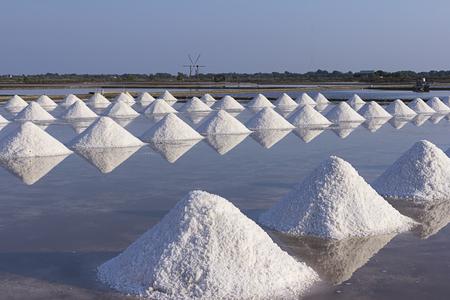 Heap of sea salt in salt farm in Thailand.