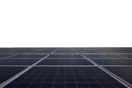 Blue photovoltaic solar panels on rooftop isolated on white background.