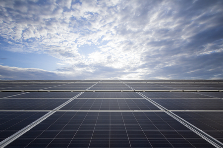Blue photovoltaic solar panels on rooftop at daylight.(Clean energy.) Reklamní fotografie