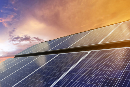 Blue photovoltaic solar panels on rooftop at twilight ,Clean energy. Reklamní fotografie