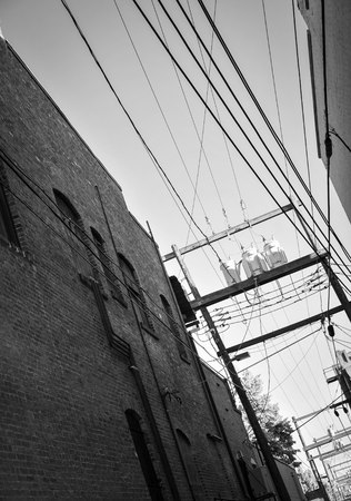 Alleyway in small down and electrical lines Stock fotó