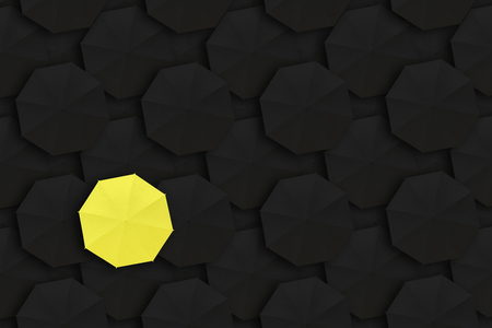 Concept of Leadership, Different and Distinction.Yellow umbrella and many black umbrellas around