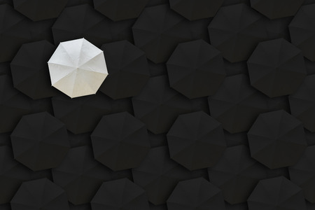 dissimilarity: Concept of Leadership, Different and Distinction.White umbrella and many black umbrellas around