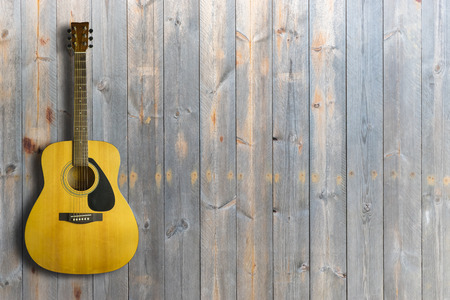 Acoustic guitar on wooden background texture.Copy space Imagens