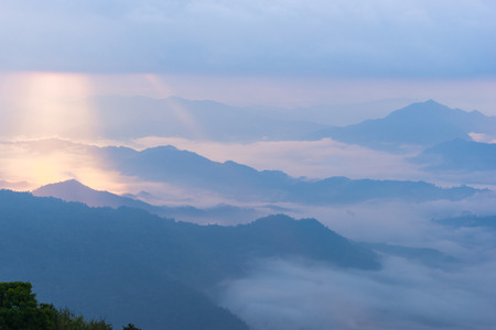 clound: Sunrise scene with the peak of mountain and cloudscape at Phu chi fa in Chiangrai Province,Thailand Stock Photo