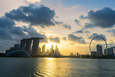 Landscape of the Singapore landmark financial district at twilight sunset scene with blue sky and clouds. Singapore downtown Editorial