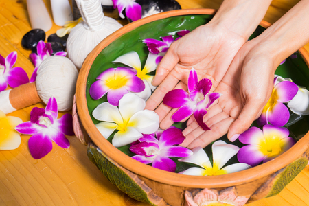 aroma bowl: Woman hands with a bowl of aroma spa water on wooden table.Spa relaxation.Spa treatment.hands Spa.massage and spa salon.Thai spa.Beautiful hand .perfect nail.nail spa.Manicure concept.Beauty spa