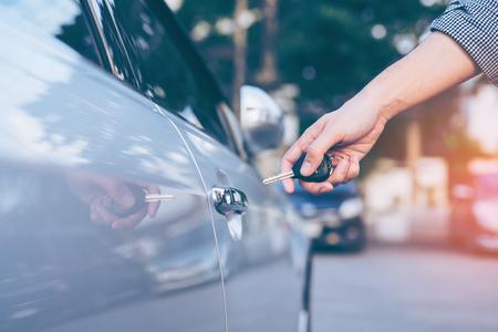 open autocar auto: Mens hand using key unlock doors car  Stock Photo