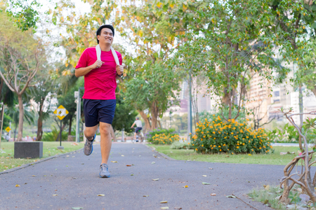 Athletic young man running at park in the city. Healthy lifestyle sport