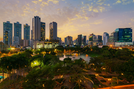 Sunset scence of Bangkok Panorama ,Aerial view of Bangkok modern office buildings and condominium in Bangkok city downtown with sunset sky and clouds at Bangkok , Thailand. Benjasiri Park