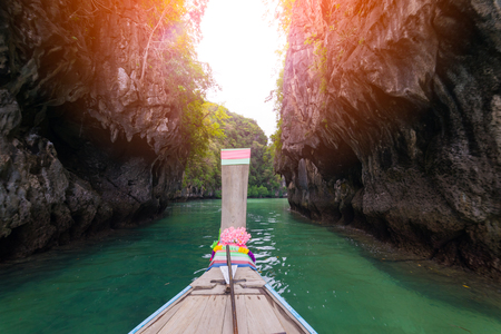 Traveler concept -  long old wooden boat traveling to Hong Islands in andaman sea Krabi, South of Thailand.