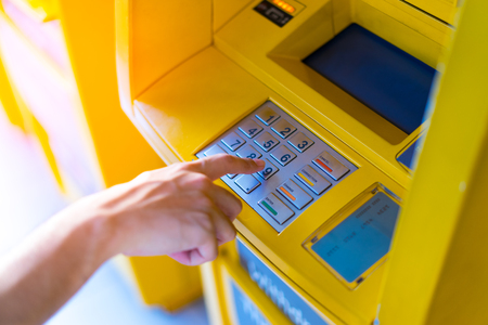 personal identification number: Man hand entering his PIN at an ATM