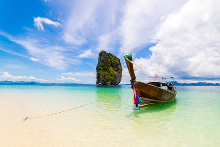 Traveling on long boat to Poda Islands in andaman sea Krabi, South of Thailand. with  blue sky and clouds