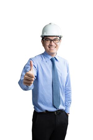 自信的年輕亞裔英俊的工程師肖像顯示大拇指被隔絕在白色背景上 版權商用圖片