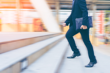 Businessman running up the stair, blurred motion Stockfoto