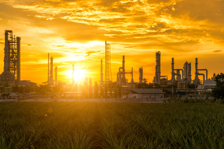 Sunrise scence of Oil Refinery factory industry with blue sky and clouds. Petrochemical plant , Petroleum , Industrial-plant.