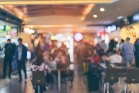 Blurred or Defocus image of restaurant or Cafeteria for use as Background with vintage tone.