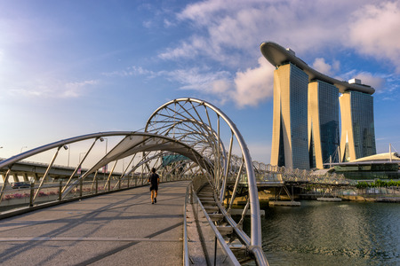 Asian man Jogging in business city of Singapore photo