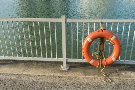 Life Buoy or  life ring and on safety barriers at the sea 版權商用圖片