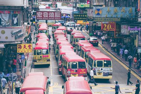 Hong Kong, China - August 14, 20157: Red Minibuses lining up, waiting for passengers at a busy station in Mongkok, Hong Kong Редакционное