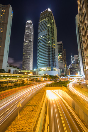 Traffic at central district in Hong Kong at sunset time. Car light trails and urban landscape in Hong Kong . 스톡 콘텐츠