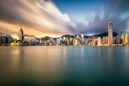 Hong Kong City skyline at sunrise. View from across Victoria Harbor Hongkong.