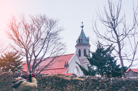 Traveler take a photo Hakodate Orthodox Church with snow at winter season at Hakodate, Hokkaido, Japan