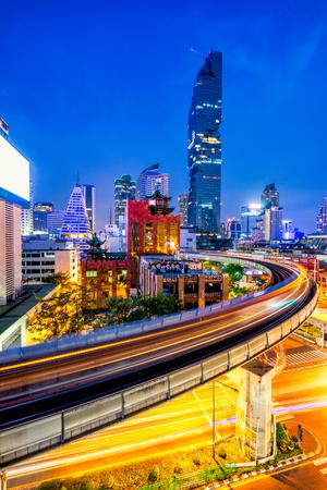 Sunset scence of Bangkok Panorama skyline ,Aerial view of Bangkok modern office buildings and condominium in Bangkok city downtown with blue sky and clouds at Bangkok , Thailand. And skytrain