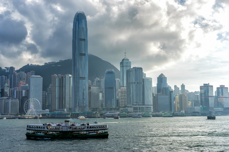 Hong Kong City skyline before sunset. View from across Victoria Harbor Hongkong.