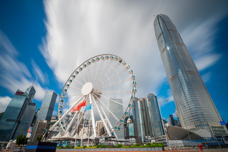 Observation Wheel in Hong Kong City skyline at sunrise. View from across central district Hongkong.