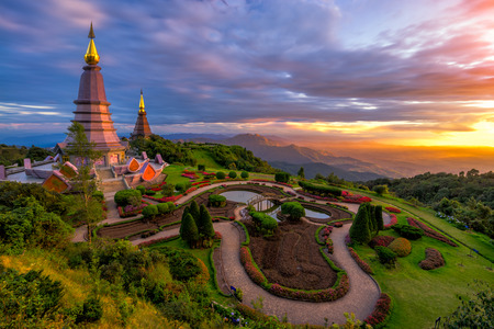 Sunset scence of two pagoda on the top of Inthanon mountain in doi Inthanon national park, Chiang Mai, Thailand. Imagens - 90462135