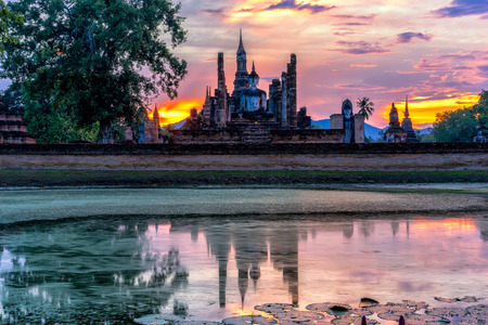 Sunset scence of Wat Mahathat temple in the Sukhothai Historical Park contains the ruins of old Sukhothai, Thailand. 스톡 콘텐츠