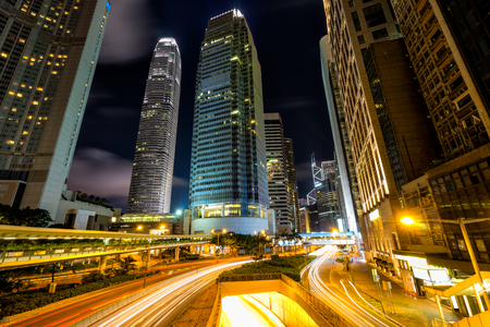 Traffic at central district in Hong Kong at dusk time. Car light trails and urban landscape in Hong Kong . 스톡 콘텐츠