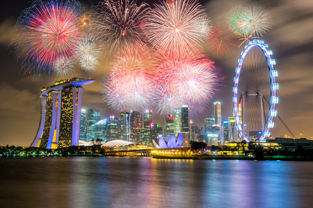 Landscape of the Singapore city landmark financial district at twilight sunset scene with Multicolor Firework Celebration. Singapore skyscraper downtown with Multicolor Firework Celebration. 에디토리얼