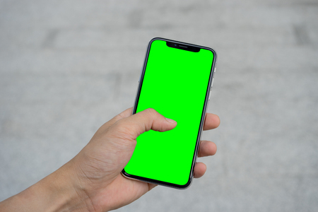 Mans hand using mobile smartphone with white screen