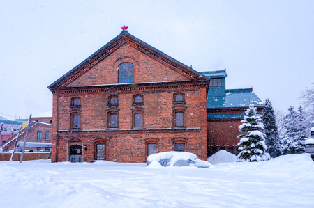 Snowing day at Sapporo Beer Museum in Sapporo, Hokkaido, Japan in winter 에디토리얼