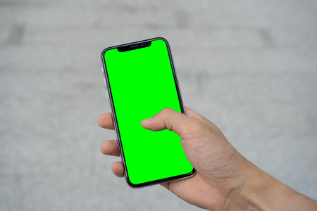 Man's hand using mobile smartphone with white screen
