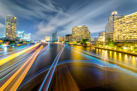 Light trails of traffic on the Chao Phraya river, Bangkok. Thailand. view from Taksin bridge Bangkok