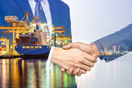 Double Exposure of a businessman handshake on the container, container ship in import export and business logistic by crane, trade Port, shipping, cargo to harbor background.