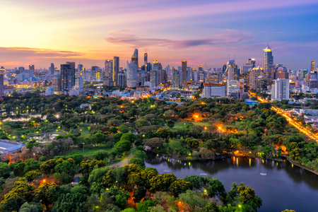 Sunset scence of Bangkok skyline Panorama ,Aerial view of Bangkok modern office buildings and condominium in Bangkok city downtown with sunset sky and clouds at Bangkok , Thailand. Lumpini park Stock Photo
